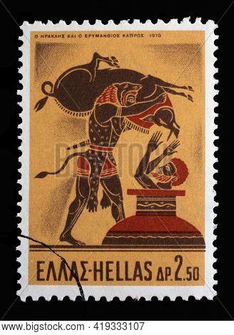 ZAGREB, CROATIA - SEPTEMBER 18, 2014: Stamp printed in Greece shows Hercules Deeds - Hercules and the Erymanthian Boar, circa 1970