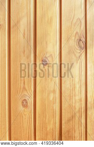 Close-up View Wall From Wooden Planks. Fragment Of The Wall, Sheathed With Vertical Planks, With A K