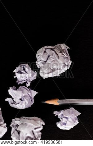 Top Close Up Shot Of Paper Waste With A Pencil Shot Over Black Background In Recycled Paper Concept