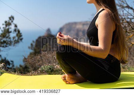 Beautiful Woman Practicing Yoga In The Park, Yoga Ardha Padmasana Half Lotus Pose.