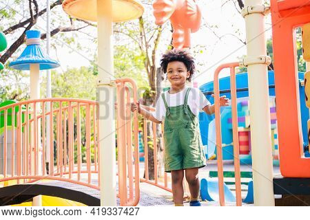 Cute African American Little Kid Boy Funny While Playing On The Playground In The Daytime In The Spr