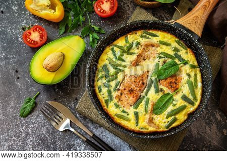 Breakfast Or Lunch Snack Concept. Rustic Omelet (omelette, Scrambled)  With Salmon Fillet And Green