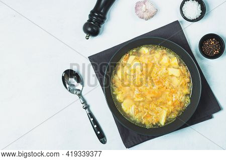 Chicken Soup Vegetables On Black Bowl On Grey Black Stone Table. Black Cooking Background
