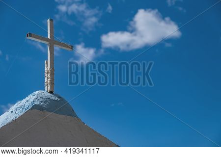 Christianity Religion Concept. White Broken Metal Rusty Old Cross Tied With Rope On Greek Island Chu
