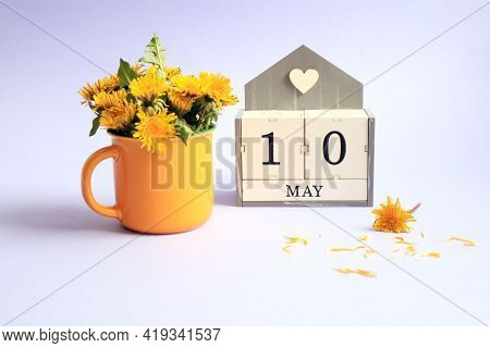 Calendar For May 10: Cubes With The Number 10, The Name Of The Month Of May In English, A Bouquet Of
