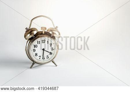 Retro Alarm Clock On Light Gray Background
