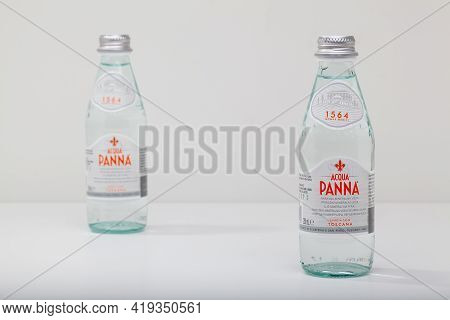 Prague,czech Republic -  12 April, 2021: Two Glassess Bottle Of Acqua Panna Toscana Mineral Still He