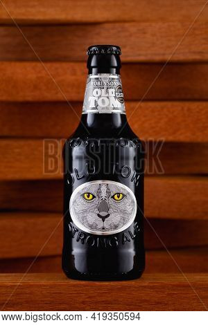 Prague,czech Republic -  2 May, 2021: Old Tom Beer On The Wooden Background.  Old Tom Named After Ro