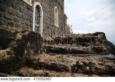 Ancient Stairs Of The Church Of Saint Peter On The Sea Of Galilee. High Quality Photo