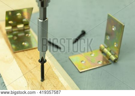 The Door Hinges Are Fastened With A Self-tapping Screw And A Screwdriver. Fastening Door Hinges, Clo