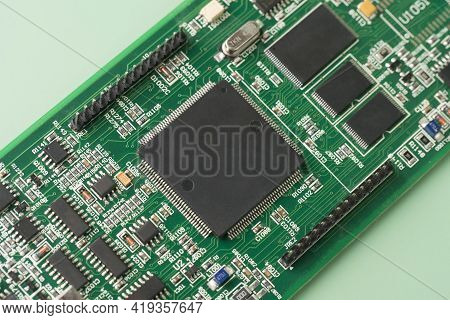 Electronic Chip Component. Printed Circuit Boards Pcb On Green Background. Minimal Industry Backdrop