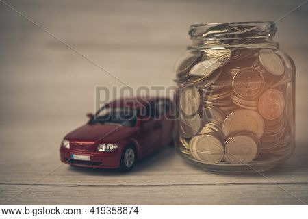 Car With Coins; Car Loan, Finance, Saving Money, Insurance And Leasing Time Concepts.