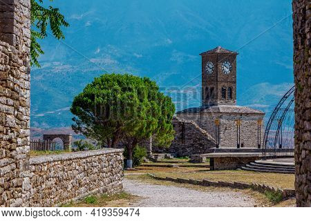 Gjirokaster Town/ Albania -august 2, 2020: View Of Clock Tower And Stone Walls At Castle Complex. Un