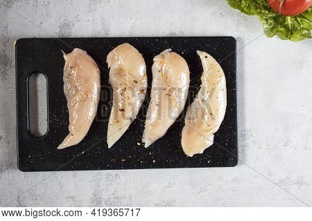 Raw Chicken Breast. Chicken Breast Fillets On A Cutting Board. Meat Chicken Breast Ingredients For C