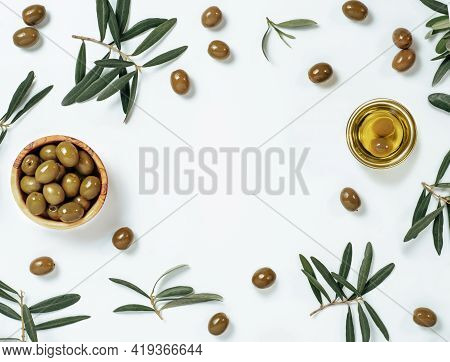 Olives And Oil Backgound With Copy Space. Set Of Green Olives And Extra Virgin Olive Oil On White Ba