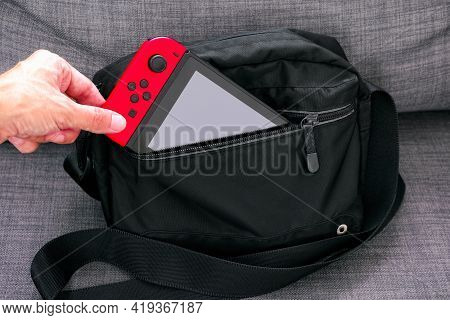 Tambov, Russian Federation - June 22, 2019 Person Hand Taking Out Nintendo Switch Video Game Console