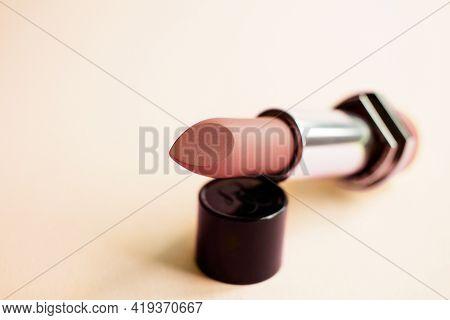 Beige Matte Lipstick Close-up On A Bright Beige  Background