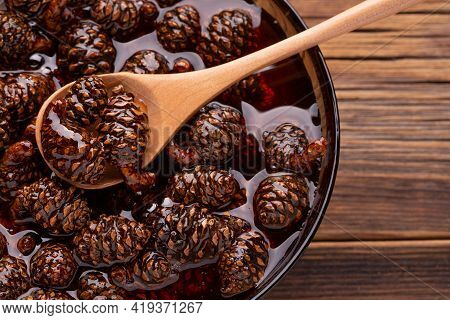 Pine Cone Jam. Small Cones In Sweet Syrup Close-up. Traditional Siberian Dessert - Young Pine Cones