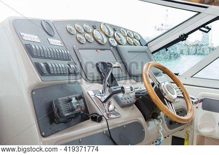 Yacht Steering Wheel Close-up. Marine Ship Control Panel. Yacht Instrument Panel.