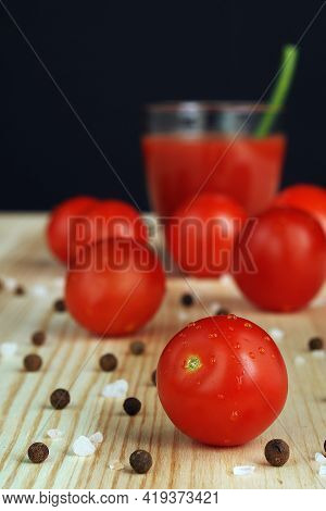 Fresh Tomatoes, Red Tomatoes. Tomato Juice Freshly Squeezed In A Transparent Glass. High Quality Pho