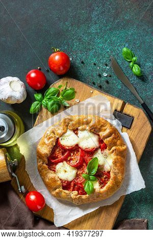 Healthy Pastries Gluten Free, Made From Rye Flour, Diet Food. Galette Tomatoes, Mozzarella And Basil