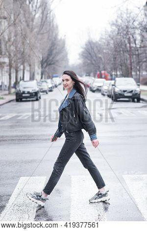 Beautiful Brunette Girl Crosses The Road On A Pedestrian Crossing