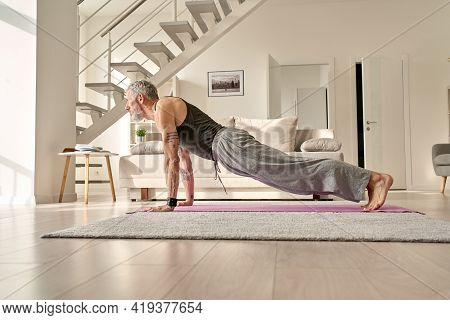 Fit Sporty Active Tattooed Senior Mature Mid Age Hipster Man Doing Plank Morning Workout Exercise At