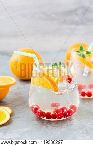 Hard Seltzer Cocktail With Orange, Cranberry And Mint In Glasses On The Table. Alcoholic Beverage. V