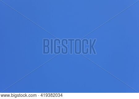 Clean Light-blue Sky Background. Perfect Texture And Background Of Light-blue Sky. A Cloudless And I
