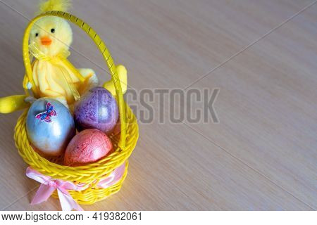 Easter Yellow Fluffy Bunny With Two Easter Chicken Eggs In A Basket. Diy Holiday Background