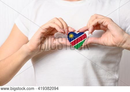 Flag Of Namibia In The Shape Of A Heart In The Hands Of A Girl. Love Namibia. Respect For Namibians