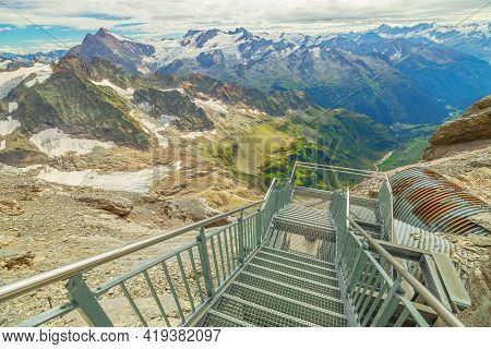 Stairway On Titlis Peak Path On Top Of Titlis Mountain With Glacier In The Uri Alps. Viewpoint 3028