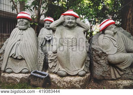 Detail Of Buddha Statues With Knitted Hat Offerings Representing The First 500 Disciples Of The Hist