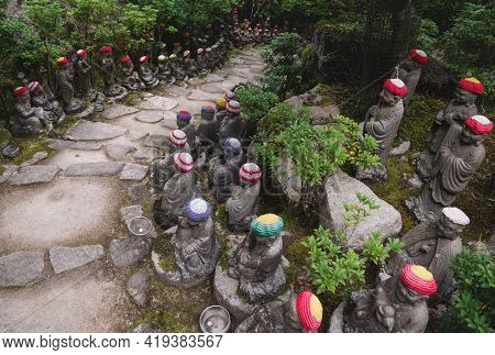 Stairs Surrounded By Buddha Statues With Knitted Hat Offerings Representing The First 500 Disciples