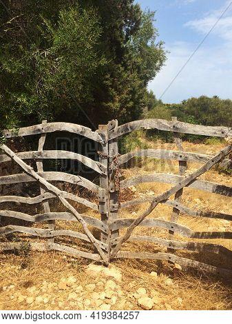 Aged Vitage Wooden Gates Close Countryside Road, Rustic Scene Somewhere In European Farm. Private Pr