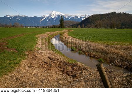 Mount Cheam Agassiz British Columbia. A Farm Field In The Fraser Valley With Mount Cheam In The Back