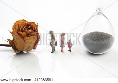 Miniature People. Concept Of Family People In Relationships On A White Background. The Problem Of Fi