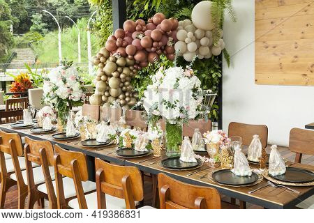 Decoration Of Party; A Long Table Decorated With Flowers For The Reception Of A Social Event.