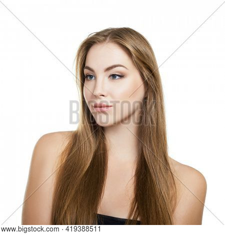 Young attractive woman with perfect make-up and long fair hair posing at studio over white background, beauty female portrait.