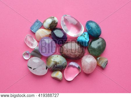 Tumbled And Rough Gemstones And Crystals Of Various Colors. Amethyst, Rose Quartz, Agate, Apatite, A