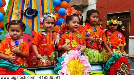 Cuenca, Ecuador - February 22, 2020: Carnival In Cuenca. Group Of Children Dressed Up In Carnival Co
