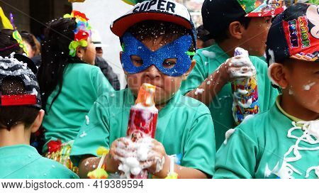Cuenca, Ecuador - February 22, 2020: Carnival In Cuenca. Little Boy In Mask In Carnival Costume With
