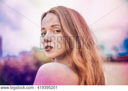 Holi Festival Of Colours. Portrait Of Happy Young Pretty Girl On Holi Color Festival. Girl Kiss With