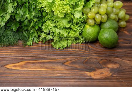 Fresh Green Vegetables And Fruits. Salad Leaves With Arugula, Lettuce, Spinach. Fitness Food Cooking
