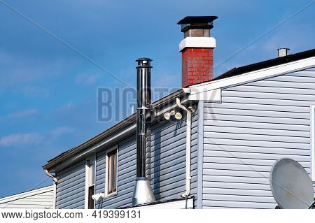 Roof With Ventilation Pipe And Flue Terminal Air