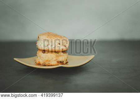 Homemade Scones On A Yellow Dish. Close Up