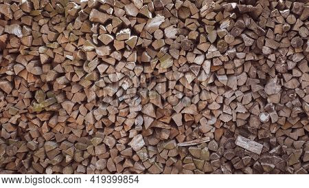 Wall Of Stacked Pine Wood Logs As Background. Pile Of Wooden Logs Stacked Together On Top Of Each Ot