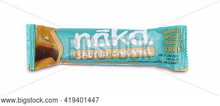 Swindon, Uk - May 5, 2021: Nakd Salted Caramel Raw Fruit And Nut Wholefood Bar On A Coloured Backgro