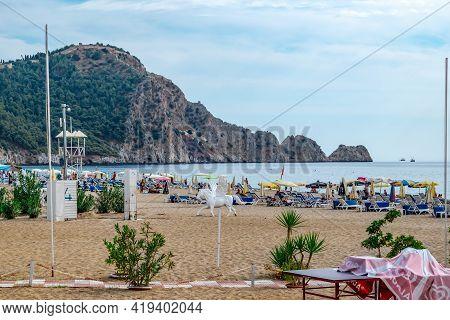 Alanya, Turkey - October 23, 2020: View Of Damlatas Beach In Alanya. Sculpture Of A Pegasus Among Th