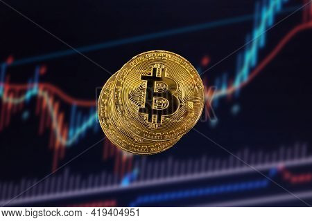 Bitcoin Coins On The Background Of The Currency Trading Chart.cryptocurrency Trading Concept.